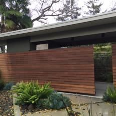 Mid-century Modern Courtyard with Sliding Ipe Fence