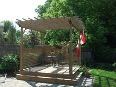 A cedar deck with a pergola top and lattice railing.  Supplied and installed by Lanark Cedar