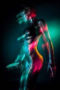 Photographer Jefta Hoekendijk's series Aura features shimmering bodies in motion and dazzling colors. The feel of these images is electric as nude models are coated from head to toe with a metallic covering. Bright greens, purples, teals, and more radiate from their every movement.