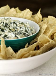 14.75 oz jar of artichoke hearts, chopped 1 brick of cream cheese (8 oz), cubed 1 cup grated Parmesan cheese 8 oz sour cream 10 oz package chopped frozen spinach 2 teaspoons minced garlic (I use minced garlic that's packed in olive oil) salt & pepper, to taste