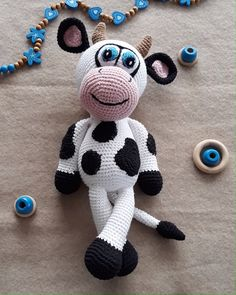 This cute cow toy is fun and easy to make. DIY your own amigurumi animal with this crochet pattern. Stuffed cow toy like this is soft, squeezable for kids to touch and play. This would also be a great baby shower gift. Crochet Cow, Crochet Animals, Easy Crochet, Stuffed Cow, Diy Stuffed Animals, Farm Animal Toys, Cow Toys, How To Start Knitting, Crochet Basics