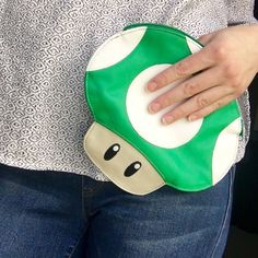Adorable Super Mario Bros Mushroom Clutch Super Mario Bros collectible 1up green mushroom pouch. Can be used as a clutch or a little storage pouch, even a makeup or cosmetic bag! Perfect for the gamer girl!  Bags