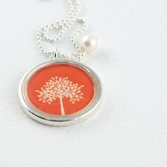 sweet tree of life orange necklace. You can purchase yours at sugarsidewalk.com and choose from other colors!