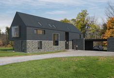 Billis house is a contemporary new build house in rural Co. The design is configured as a long house, a simple confident form, composed of traditional materials; stone, slate, concrete and timber. Grand Designs Uk, Cottage Design, House Design, Long House, Rural House, Stone Barns, New Builds, Contemporary Architecture, Building A House