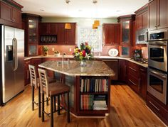 I would have done darker cabinets and lighter granite...and a longer island....but i like the general idea