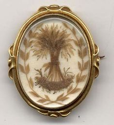 More than likely this is a wedding gift instead of a memorial piece. During the early to mid 1800's, in France and Belgium, it was customary for the grooms' parents to give the bride a piece of jewelry depicting a sheaf of wheat motif. Generally, the motif was made from the grooms' hair...this piece is completely done in hairwork...circa 1840-60