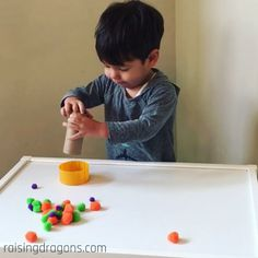 Roll Ball Drop Toddler Activity * ages ⋆ Raising Dragons Such a fun toddler activity to improve fine motor skills!Such a fun toddler activity to improve fine motor skills! Fun Activities For Toddlers, Motor Skills Activities, Preschool Learning Activities, Infant Activities, Teaching Kids, Indoor Activities, Preschool Ideas, Baby Sensory Play, Baby Play