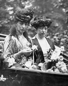 Queen Alexandra and Princess Victoria.  They look like sisters here instead of mother and daughter.