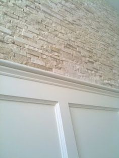 Stone wall and wainscoting for basement stairs
