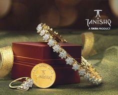 Gold and Diamond jewellery designs: tanishq diamond bangle and diamond ring