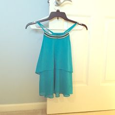 NWOT Turquoise Tank Top Size XS tank top in a turquoise color- the real color has more green than the pictures. True to size and a super cute too- it can be dressed up and down! Brand new without tags. Iz Byer Tops Tank Tops