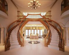 Contemporary symmetrical staircase with wood and iron accents | beautiful design for a double or dual staircase
