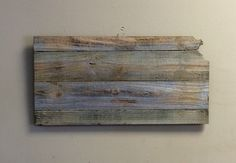 A personal favorite from my Etsy shop https://www.etsy.com/listing/400328581/kansas-state-shape-rustic-wood-sign