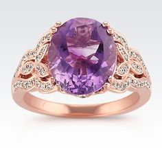 This regal and magnificent ring is part of our Studio collection and has a dazzling center focal point of one oval purple amethyst (approx. 3.80 carats). Vintage-inspired detailing consumes the design and is accented by 58 round diamonds (approx. .28 carat TW) pavé-set in quality 14 karat rose gold. Complete your attire with this 12mm queenly ring. The total gem weight of this ring is approximately 4.08 carats.
