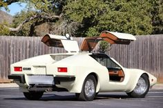 The coupé body, which has gullwing doors, was designed by former Brabham Formula One engineer Max Boxstrom and gives the car a Cd of 0. Description from quazoo.com. I searched for this on bing.com/images