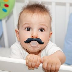 Pacifiers that give your baby a mustache are a necessity.