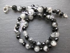 Tourmalinised quartz with faceted onyx necklace. SOLD.