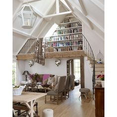 Book loft. amazing wood beams and staircase