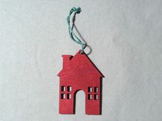 Festive Ornament House, Red with Blue String. Featured in 2014's November issue of HGTV™ magazine.