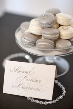 Gray and cream French macarons for a wedding.
