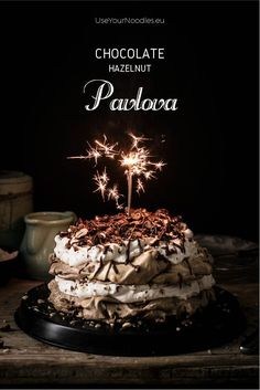 Beautiful layers of crispy and chewy meringue, decadent chocolate ganache and fluffy whipped hazelnut cream are what make this delicious chocolate hazelnut pavlova cake worth celebrating this blog's first birthday. Click to find the whole recipe or pin an