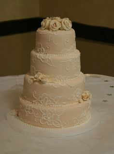 4 tier wedding cake with icing embroidery technique and sugar roses