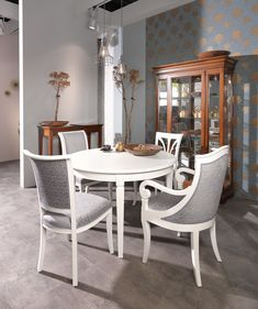 "The popular ""Villa Borghese"" table in mix with the beautiful ""Verdi"" china cabinet (back is with crystal mirror and interior lighting), 4 different chairs (Marie, Villa Borghese, Milano, Clara) and 2 ""Luna"" flower stands.  #selva #selvafurniture #selvamöbel #selvatimeless #italianfurniture #classicitalianfurniture #classicfurniture #klassischemöbel #möbelmitstil #highqualityfurniture  #handcraftedfurniture #vintagestyle #romanticliving #romantischwohnen #romanticfurniture #romanticdining"