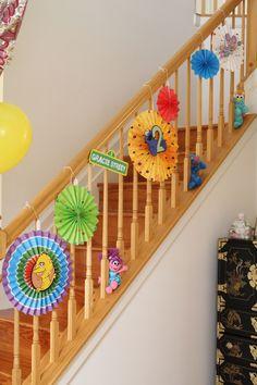 Gracie's Sesame Street Birthday Party decorations (Sesame Street First Birthday hanging fan kit with custom Cricut center additions)