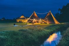Two Giant Hats and catering annex set up with lots of festoon lighting. Gorgeous night time shot by Christopher Terry Photography.