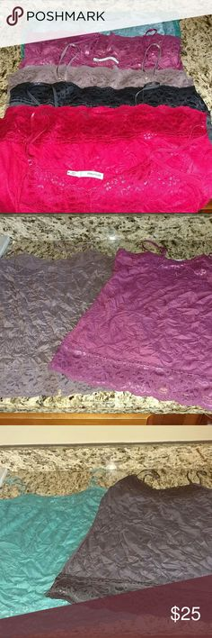 6 crinkle camis 6 crinkle Cami's in excellent condition. No stains tears or snags. Great for layering. Just have too many. All size medium except lighter purple one which snuck in there as a small. Maurices Tops