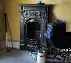 cast iron fireplace with ornate castings depicting vines