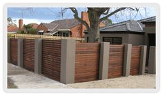 Merbau timber feature front fence with rendered columns in Brighton. Description from willdevelop.com.au. I searched for this on bing.com/images