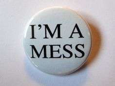 """This I'm A Mess"""" button measures 1 1/2 inches wide. Reproduction of a vintage design! Adorn your denim jacket, messenger bag, guitar strap and more! Designed and produced in Denver, CO."""