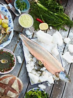 Whole baked salmon in salt With homemade basil mayo & chilli salsa    Baking salmon in a thick layer of salt not only looks incredible, but ...