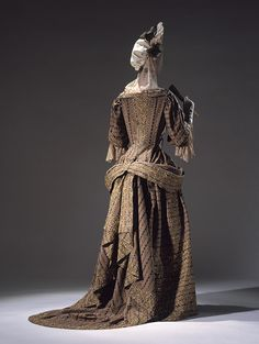 Mantua, late 17th century British Taupe wool with stripes of dull orange and blue, embroidered in silver-gilt thread