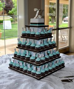 "Seems like the top with the monogram on it is a mini cake for the bride and groom and the rest of the ""tiers"" are cupcakes for the guests! :)The mini cake could be jamaican wedding cake. cupcakes by our friend. Tiffany Party, Tiffany Wedding, Tiffany Blue Weddings, Tiffany Theme, Blue Wedding Cupcakes, Blue Cupcakes, Square Cupcakes, Cupcake Wedding, Mini Cakes"