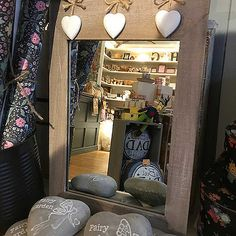 We have these lovely 'Ashley Farmhouse' Portrait Mirrors in store and online.. with 3 Hanging Hearts from 'Sass & Belle' with hooks on the back for wall mounting and Measures: 40 x 26cm