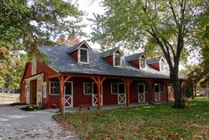 Dream Barns: This durable painted block building has a timber frame porch to enhance it. This building has an apartment above. by B&D Builders www.custombarnbuilding.com