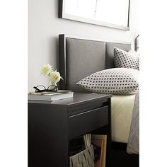 Clean, double-paneled inset headboard upholstered in style-conscious charcoal adds soft contrast to sleek, architectural black metal frame. Mark Daniel-designed bed features a slim silhouette that will work in rooms both small and spacious.Clean, double-paneled inset headboard upholstered in style-conscious charcoal adds soft contrast to sleek, architectural black metal frame. Mark Daniel-designed bed features a slim silhouette that will work in rooms both small and spacious.