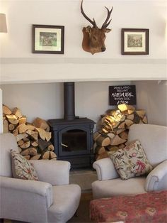 White neutral fireplace with log burner