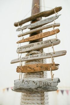 Driftwood Sign Post Indie Rustic Beach Marquee Wedding http://www.abiriley.co.uk/
