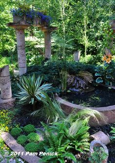 """Not far from the patio where we ate, but hidden from view until you enter the space, stands a romantic, flower-topped """"ruin"""" and circular pond."""