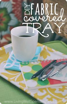 DIY Fabric Covered Tray.  All you need is a little scrap fabric, spray adhesive, and some Mod Podge to transform an old cookie sheet into a darling designer-inspired tray!   Such a great gift idea!