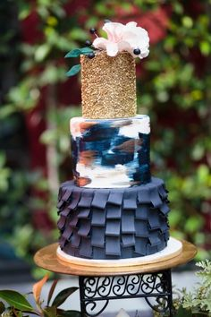 Fondant ruffle wedding cake with gold sequins by Frost It Cakery. Navy blue and gold wedding cake