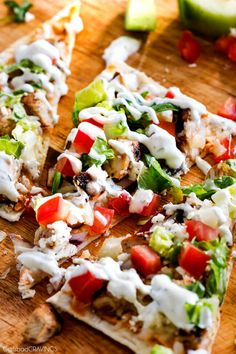 quick and easy Chicken Gyro Flatbread Pizzas layered with sun-dried tomato basil hummus, juicy Greek Chicken, mozzarella, feta & easy Blender Tzatziki!