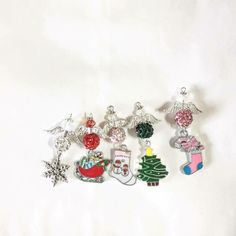 These Christmas Charm Angels are a wonderful gift to give at Christmas especially in the persons favorite colour, they are enamelled charms, there is 5 charms to choose from Sleigh, Christmas tree, Snowmen and Snowflake designs Personalised Bauble, Christmas Gifts, Christmas Tree, Snowflake Designs, Bespoke Jewellery, Initial Charm, Wedding Bouquets, Favorite Color, Snowflakes