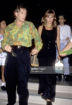 Actor Jean-Claude Van Damme and Model Darcy LaPier leave the CNN Building after Taping of 'Larry King Live' on August 27, 1993 at CNN Building in Hollywood, California.
