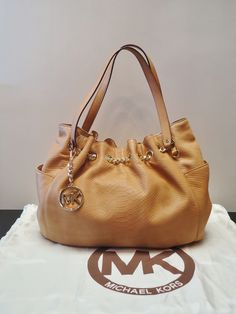 Luxurious Michael Kors Tote in Camel with gold hardware at Ms. Mulligan's Consignment Boutique
