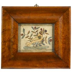 """Pennsylvania pen and ink fraktur reward of merit, early 19th c., of a bird with a berry branch in its beak, surrounded by foliate and floral branches, 3"""" x 4"""". Provenance: An Alexandria, Virginia estate...."""