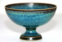 "Stig Lindberg, Gustavsberg - Unique delicate footed bowl with fantastic glaze. Thin delicate unique footed stoneware bowl with absolutely stunning turquoise and black glaze by Stig Lindberg for Gustavsberg 1963"" Incised ""G (hand) Stig L."" Height 1 3/4"" (4,5 cm) Width 2 4/5"" (7 cm)."